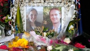 Photographs of Sydney's cafe siege victims, lawyer Katrina Dawson (L) and cafe manager Tori Johnson are displayed in a floral tribute near the site of the siege in Sydney's Martin Place, December 23, 2014