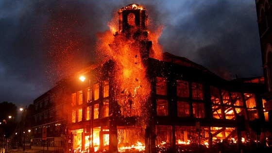 A fire rages through a building in Tottenham, north London, during last summer&#x27;s riots.