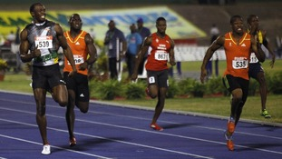 Usain Bolt and Yohan Blake compete in the men's 200 meters final at the Jamaican Olympic trials in Kingston