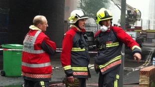 Fire officers at the scene of the fire in Lenton