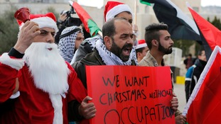 The protesters were demanding free movement for Palestinians over Christmas