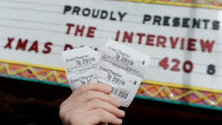 Tickets for the film The Interview is seen held up by theater manager Donald Melancon for the media at Crest Theater in Los Angeles.