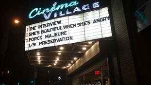 A cinema displays The Interview.
