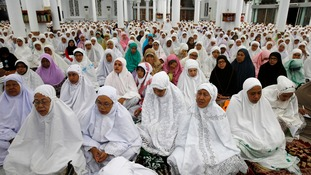 Acehnese women attend a mass prayer at the mosque that was one of the few buildings left standing in Banda Aceh, the city flattened by the tsunami.