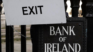 A sign hangs on the railings of the Bank Of Ireland, in central Dublin