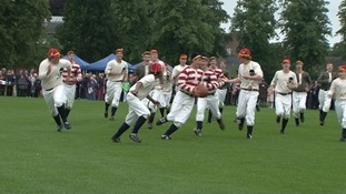 Students in period dress playing Rugby this morning