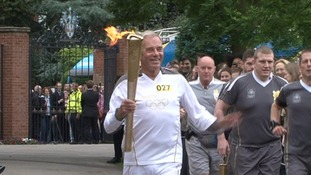 Keith Richards carrying the flame into Rugby School this morning