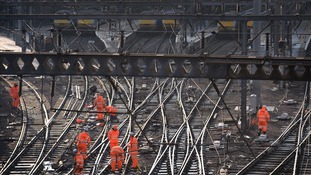 Railway workers on the tracks outside King's Cross today.