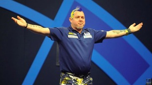 Peter Wright salutes the crowd after his second round victory.