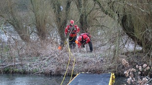 Fire crews install inflatable walkway on frozen pond