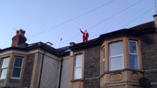 Santa appears on the rooftops of Bristol