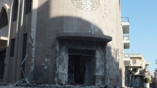 Damaged entrance of a mosque in Homs after fighting between Syrian rebel fighters and Bashar al-Assad's forces.