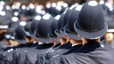 Police graduates at their passing out ceremony at the Hendon police academy, London. 