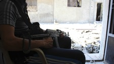 A member of the Free Syrian Army keeps watch in Baba Amr neighbourhood in Homs.