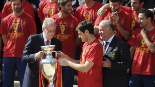 Spain's national soccer team captain Iker Casillas gives the Euro 2012 trophy to Spain's King Juan Carlos