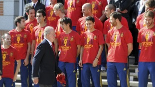 Spain's King Juan Carlos arrives to his place for a family photo with Spain's national football team