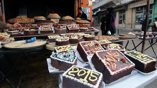 New Year cakes are displayed outside a shop in Sheikh Maksoud neighbourhood of Aleppo