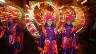 Children take part in the light festival on New Year's Eve.