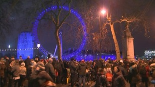 Crowds wait for the fireworks display next to the River Thames in London