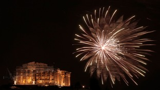 A firework explodes in front of the Parthenon in the Greek capital Athens