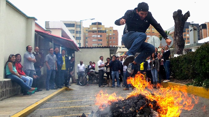 A man jumps the flames for luck