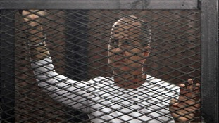 Australian Peter Greste behind bars in Egypt.