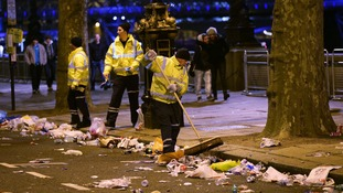 Workers begins to clear away mess left by members of the public on the Embankment in central London.