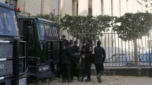 Riot police stand guard in front of an appeals court in Egypt's capital Cairo.
