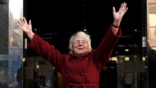 Pensioner Kathleen Danby threw her arms in the air when she was freed at Birmingham's civil court.
