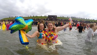 Brave swimmers take part in New Year's Dips