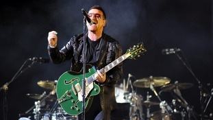 Bono is U2's singer but occasionally plays guitar on stage.