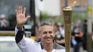 Gary Lineker carries the flame through Leicester today.