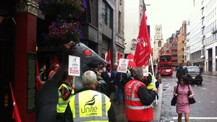 Unite union members crowd the pavement.