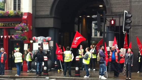 Union members wave placards and flags.