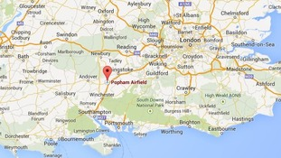 Two die as light aircraft crashes into woodland.