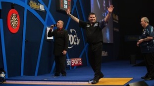 Anderson celebrates hitting the winning double as Taylor looks on