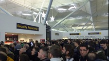 Passengers queuing at Stansted