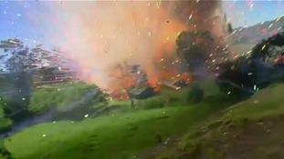 The blast sends a rush of rockets through the air.