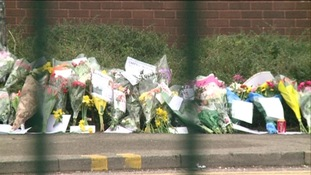 Floral tributes through gates