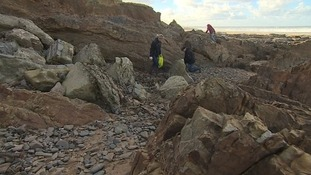Volunteers tidying Crooklets beach in Bude