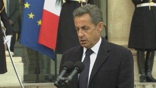 Former French president Nicolas Sarkozy speaks outside the Elysee Palace.