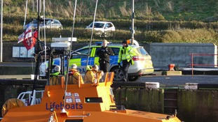 Police and the RNLI have been searching the harbour and coast.