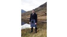 Man wears traditional Scottish kilt