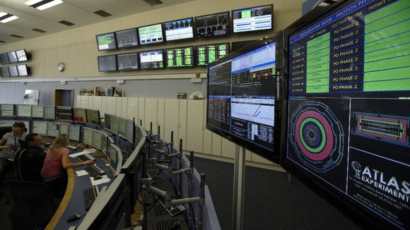 Technicians look at computer screens during the preparation of the beam in the Control Room of the Large Hadron Collider at Cern.