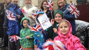 Parents and children brave the rain for the Olympic Torch in Market Deeping