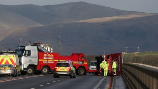 A lorry lies on its side after being blown over in strong winds on the Clackmannanshire Bridge over the Firth of Forth, Scotland,