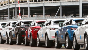 File photo dated 21/10/12 of Range Rover Evoque cars, made by Land Rover sit at the docks in Southampton awaiting export as sales of Jaguar Land Rover (JLR) vehicles roared ahead last year.