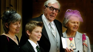 Sykes is accompanied by daughter Kathy, grandson Thomas and wife Edith after receiving his CBE from the Queen.