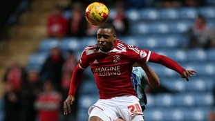 Jon Obika rises high to win the ball at the Ricoh arena