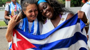 Recently released dissidents Aide Gallardo (L) and Sonia Garro hold the Cuban national flag during a march in Havana January 11, 2015.